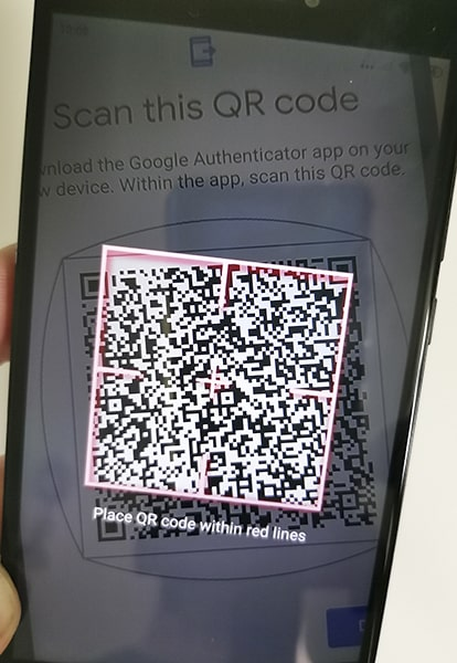 Scanning QR codes displayed on an old phone using a new phone camera.