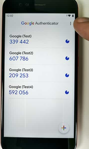 Accessing menu by tapping three dots in the Google Authenticator app.